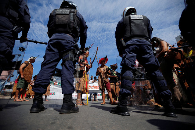 Indigenous people attend a protest defending indigenous land, education and the indians health in front of the Planalto Palace, in Brasilia, Brazil, June 4, 2019. (Photo by Adriano Machado/Reuters)