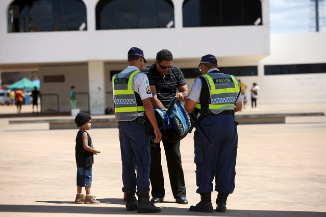 A man shows the content of his bag to police in Brasilia, Brazil April 17, 2016. (Photo by Adriano Machado/Reuters)