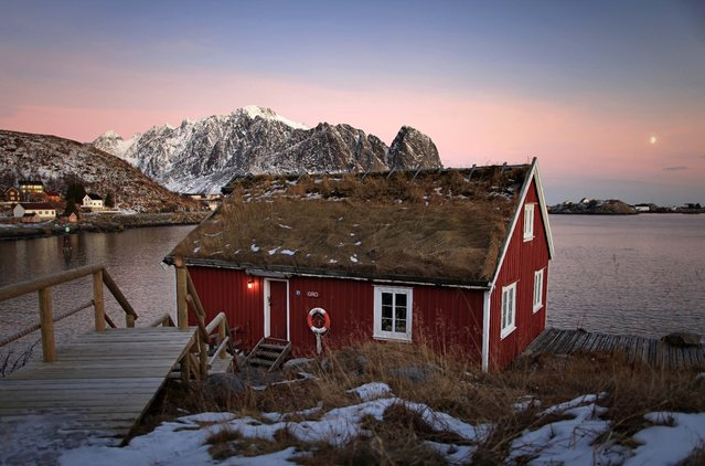 """""""Typical red rorbu huts Reine – Lofoten """". Typical red rorbu huts with sod roof in town of Reine on Lofoten. Photo location: Reine, Lofoten Islands, Norway. (Photo and caption by Sausse David/National Geographic Photo Contest)"""