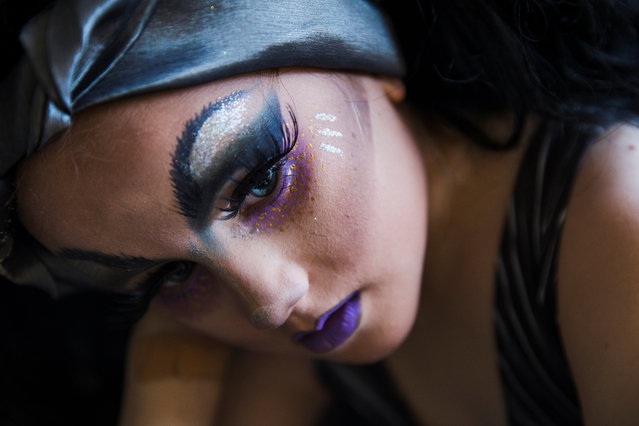 """Keegan, 8, who identifies as gender creative, relaxes after a drag class at the home of his """"Fairy Drag Mothers"""", Robby and Alex, near Austin, Texas, U.S., August 14, 2018. Keegan's parents sought the help of the drag community to help mentor their son, who identifies as gender creative and recently came out as gay, to aid him with his drag skills. His mother, Megan, says the family was surprised that Keegan came as gay at the early age of 9, but happy he is relieved to have the weight lifted off his shoulders. (Photo by Amanda Voisard/Reuters)"""