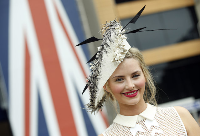 Eleanor Matthews poses for photographers as she arrives for the second day of  Royal Ascot horse racing meet at Ascot, England, Wednesday, June 17, 2015. Royal Ascot is the annual five day horse race meeting that Britain's Queen Elizabeth II attends every day of the event.(AP Photo/Alastair Grant)