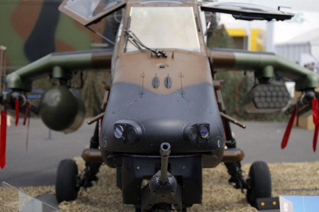 The nose of Tigre HAD Helicopter with a machine gun is parked at the Paris Air Show, in Le Bourget airport, north of Paris, Tuesday, June 16, 2015.  Some 300,000 aviation professionals and spectators are expected at this week's Paris Air Show, coming from around the world to make business deals and see aeronautic displays. (AP Photo/Francois Mori)