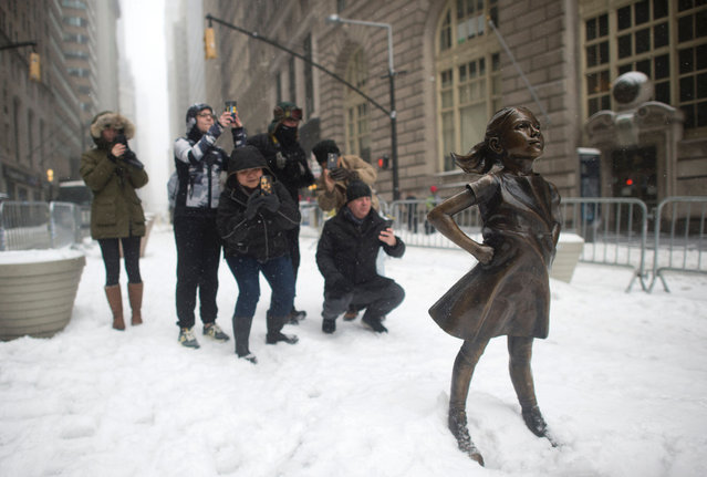 The Fearless Girl statue stands in the snow March 14, 2017 in New York. (Photo by Don Emmert/AFP Photo)
