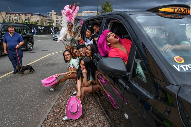 The cast of the Lady Boys of Bangkok squeeze into a taxi during a fundraising event for Edinburgh taxi drivers children's charities on August 7, 2019 in Edinburgh, Scotland. The Lady Boys of Bangkok have returned to the Fringe for a 21st season, appearing at the Theatre Big Top at Fountainbridge from August 2nd – 26th. (Photo by Jeff J. Mitchell/Getty Images)