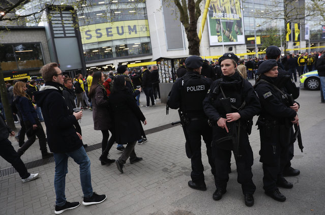 Police patrol outside the ground prior to the UEFA Champions League Quarter Final first leg match between Borussia Dortmund and AS Monaco at Signal Iduna Park on April 12, 2017 in Dortmund, Germany. The match was rescheduled after an alleged terrorist attack on the Borussia Dortmund team coach as it made it's way to the stadium. (Photo by Maja Hitij/Bongarts/Getty Images)