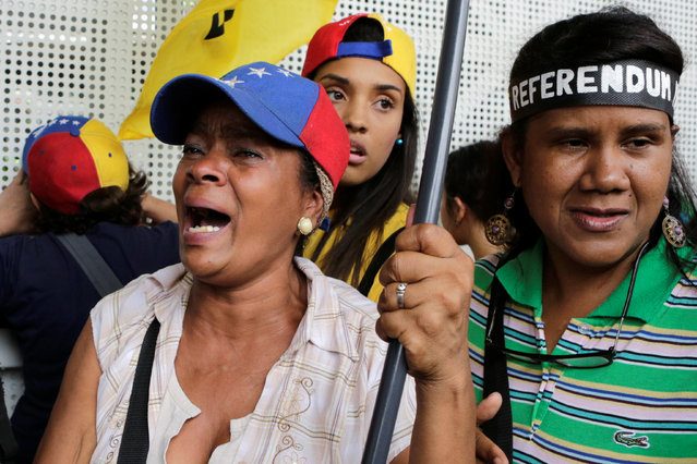 An opposition supporter reacts during a rally to demand a referendum to remove President Nicolas Maduro in Caracas, Venezuela, May 11, 2016. (Photo by Marco Bello/Reuters)