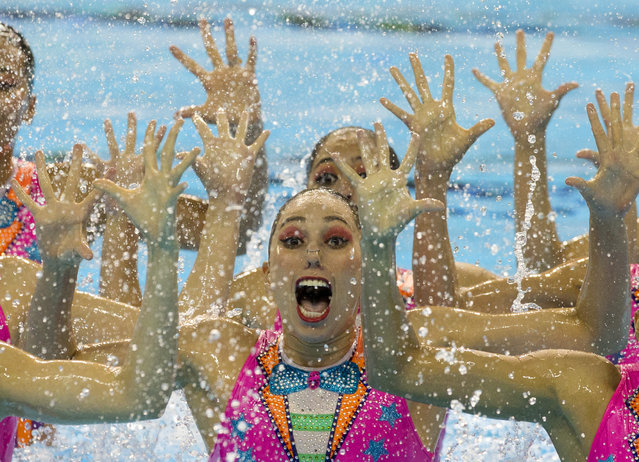 Members of Mexico's synchronised swimming team perform a clown inspired number for their free routine at the Pan Am Games in Toronto, Saturday, July 11, 2015. (Photo by Rebecca Blackwell/AP Photo)