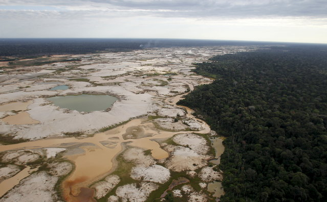 An area deforested by illegal gold mining is seen in a zone known as Mega 14, in the southern Amazon region of Madre de Dios July 13, 2015. (Photo by Janine Costa/Reuters)