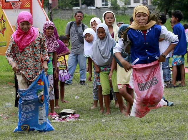 Muslim children play sack race during Eid-al-Fitr celebration in Taguig city, south of Manila July 18, 2015. (Photo by Romeo Ranoco/Reuters)