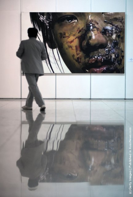 A visitor views the work entitled 'I am An Actor 1' by Chinese artist Li Haide