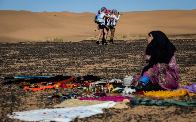"Women take part in the desert trek ""Rose Trip Maroc"", on November 1, 2019 in the erg Chebbi near Merzouga. The Rose Trip Maroc is a female-oriented trek where teams of three must travel through the southern Moroccan Sahara desert with a compass, a map and a topographical reporter. (Photo by Jean-Philippe Ksiazek/AFP Photo)"