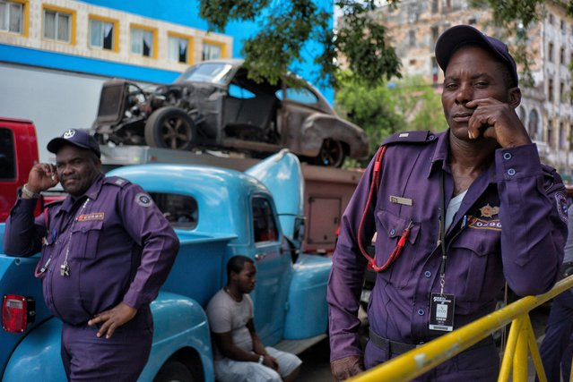 "Cuban policemen guard a large area fenced off for the filming of ""Fast & Furious 8"" in Old Havana, Cuba, May 3, 2016. (Photo by Dotan Saguy)"