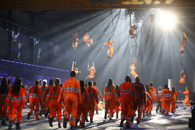 Performers dressed as miners, take part in a show during the opening ceremony of the NEAT Gotthard Base Tunnel, the world's longest and deepest rail tunnel, near the town of Erstfeld, Switzerland June 1, 2016. The 57.1-km (35.5 mile)-long Gotthard Base Tunnel, 17 years under construction and designed to last a century, is part of a 23 billion Swiss franc (23.1 billion USD) infrastructure project to speed passengers and cargo by rail below the Alps, as much as 2.3 km (1.7 miles) under the mountain chain, that divides Europe's north and south. (Photo by Ruben Sprich/Reuters)
