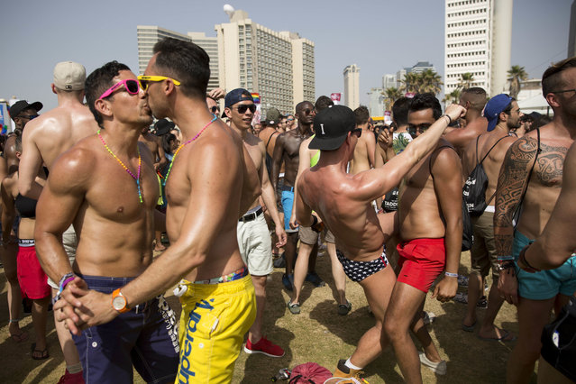 People dance during the annual Gay Pride Parade in Tel Aviv, Israel, Friday, June 3, 2016. (Photo by Oded Balilty/AP Photo)