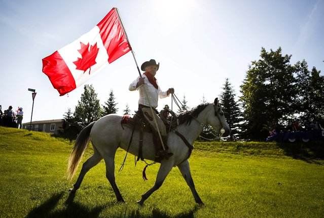Harry Harder rides his horse Dotte-Dee-Bar during Canada Day celebrations in Cremona, Alta., Tuesday, July 1, 2014. (Photo by Jeff McIntosh/Reuters)
