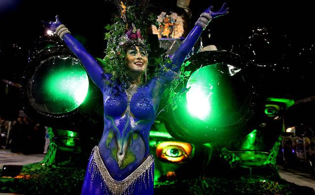 A dancer performs during the Carnival parade of the Imperio de Casa Verde samba school in Sao Paulo