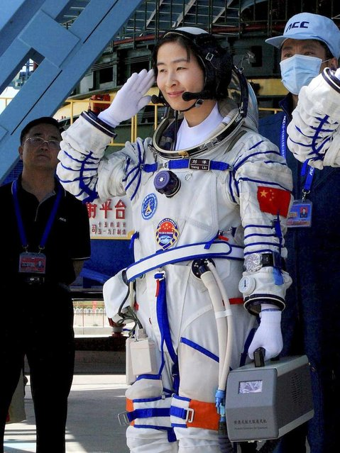 China's first female astronaut Liu Yang, waves during a sending off ceremony before she departs for the Shenzhou 9 spacecraft rocket launch pad at the Jiuquan Satellite Launch Center in Jiuquan, China, Saturday, June 16, 2012