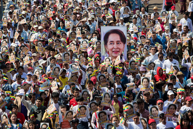People participate in a rally in support of Myanmar's State Counsellor Aung San Suu Kyi, as she prepares to defend Myanmar at the International Court of Justice in The Hague against accusations of genocide against Rohingya Muslims, in Yangon on December 10, 2019. Nobel peace laureate Aung San Suu Kyi is set on December 10 to personally defend Myanmar in The Hague against accusations of genocide, in a remarkable fall from grace for the woman once hailed as a rights icon. (Photo by Sai Aung Main/AFP Photo)