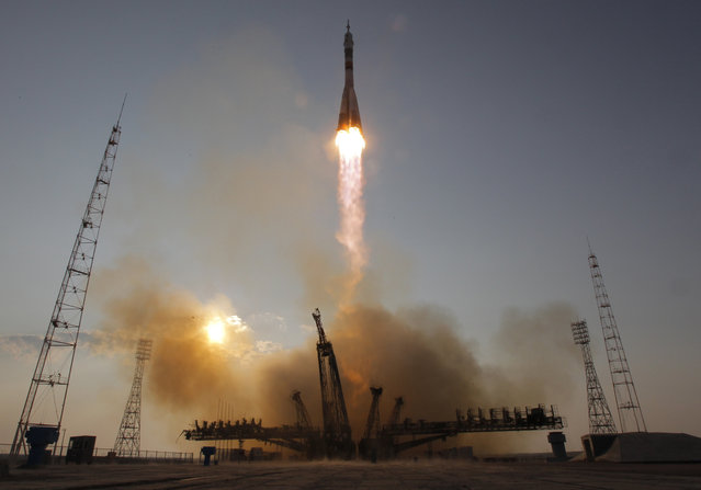 The Soyuz-FG rocket booster with Soyuz MS space ship carrying a new crew to the International Space Station, ISS, blasts off at the Russian leased Baikonur cosmodrome, Kazakhstan, Thursday, July 7, 2016. (Photo by Dmitri Lovetsky/AP Photo)