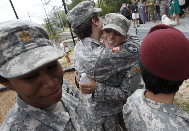 Capt. Kristen Griest of Orange, Connecticut (Center-R) is congratulated after Ranger school graduation at Fort Benning in Columbus, Georgia August 21, 2015. The two pioneering women made history on Friday as they became the first females to graduate from the Army's elite and grueling 62-day Ranger school, at Fort Benning, Georgia. (Photo by Tami Chappell/Reuters)