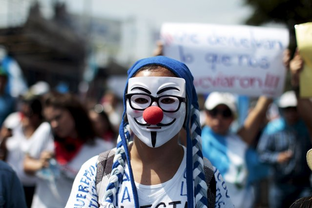 A San Carlos University student participates in a demonstration to demand for the resignation of Guatemalan President Otto Perez Molina in Guatemala City, Guatemala, August 27, 2015. (Photo by Jose Cabezas/Reuters)