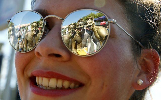 Posing revellers are reflected in the sunglasses of a woman during the 24th Street Parade dance music event in Zurich, August 29, 2015. (Photo by Arnd Wiegmann/Reuters)