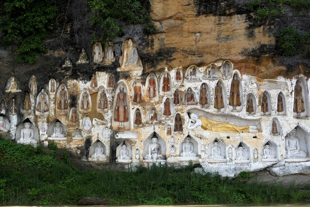 Buddha images, carved into the cliff from mid-19 century, are seen at Akauk Taung (Tax Mountain) at  Irrawaddy river Bank outside Htonebo, Bago division August 24, 2014. (Photo by Soe Zeya Tun/Reuters)