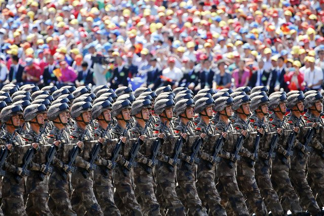 China's People's Liberation Army soldiers march with their weapons at Tiananmen Square during the military parade marking the 70th anniversary of the end of World War Two, in Beijing September 3, 2015. (Photo by Damir Sagolj/Reuters)