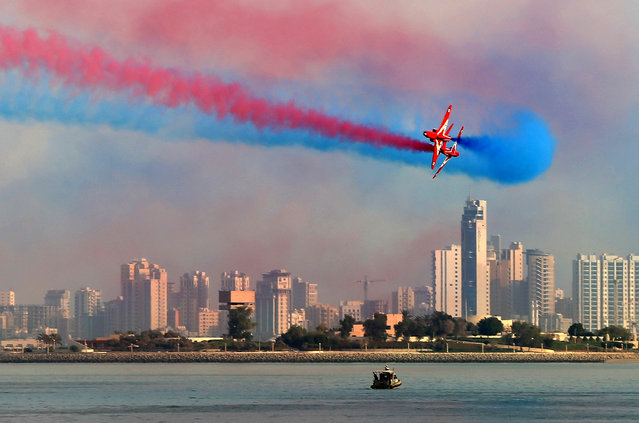 "The British Royal Air Force's (RAF) aerobatic team, the ""Red Arrows"", performs aerial manoeuvres during an airshow in Kuwait City on September 28, 2017. (Photo by Yasser Al-Zayyat/AFP Photo)"