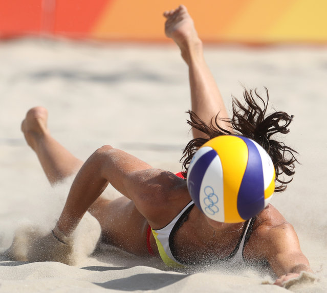 Spain's Elsa Baquerizo dives for a ball during a women's beach volleyball match against Argentina at the 2016 Summer Olympics in Rio de Janeiro, Brazil, Saturday, August 6, 2016. (Photo by Petr David Josek/AP Photo)