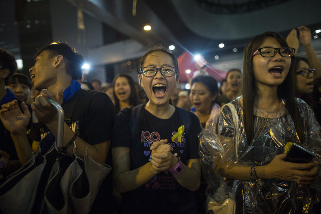 Student protesters chant pro-democracy slogans on the streets on September 30, 2014 in Hong Kong, Hong Kong. Thousands of pro democracy supporters continue to occupy the streets surrounding Hong Kong's financial district. Protest leaders have set an October 1st deadline for their demands to be met and are calling for open elections and the resignation of Hong Kong's Chief Executive Leung Chun-ying. (Photo by Paula Bronstein/Getty Images)