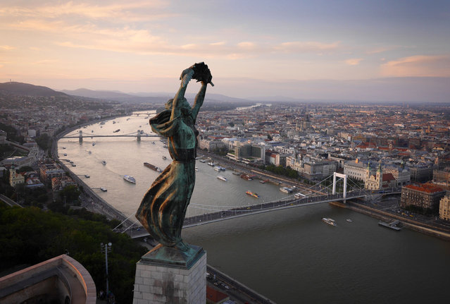 The windswept Liberty Statue overlooking Budapest, Hungary. (Photo by Amos Chapple/Rex Features)