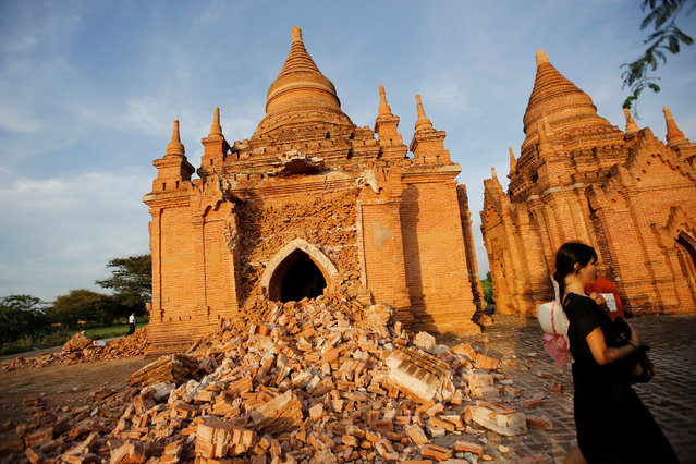 A woman walks past a damaged pagoda after an earthquake in Bagan, Myanmar August 25, 2016. (Photo by Soe Zeya Tun/Reuters)