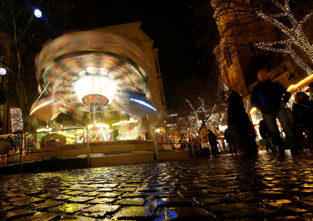 A carousel is seen at a Christmas market in tDortmund, Germany, November 30, 2017. Picture taken with long exposure. (Photo by Leon Kuegeler/Reuters)