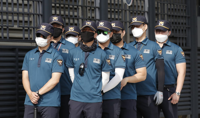 South Korean police officers wearing face masks to help protect against the spread of the new coronavirus, stand guard outside of Foreign Ministry in Seoul, South Korea, Wednesday, July 8, 2020. (Photo by Lee Jin-man/AP Photo)