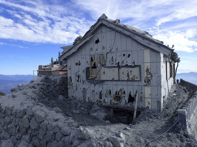 A hut damaged by volcanic bomb and ashes are seen near the peak of the Mount Ontake, which erupted September 27, 2014 and straddles Nagano and Gifu prefectures, central Japan, in this handout photograph released by Joint Staff of the Defence Ministry of Japan and taken October 12, 2014. (Photo by Reuters/Joint Staff of the Defence Ministry of Japan)