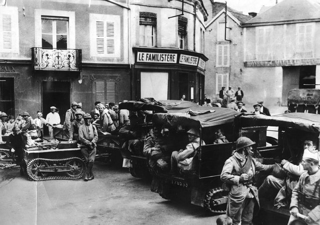 French jeeps with caterpillar treads towing  mini tanks, stop at a French village, circa 1918. (Photo by Hulton Archive)