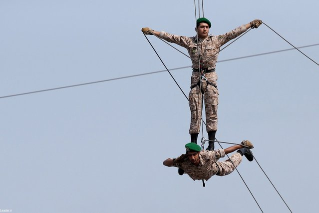 Members of the Iranian forces perform during a graduation ceremony for Iranian Navy cadets in the northern city of Nowshahr, Iran September 30, 2015. (Photo by Reuters/leader.ir)