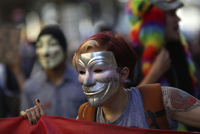 Protesters wear Guy Fawkes masks during a demonstration in San Francisco, California November 5, 2014. (Photo by Robert Galbraith/Reuters)