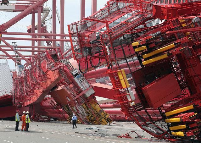Port staff check the damaged bridge cranes in Kaohsiung, southeast China's Taiwan on September 15, 2016. Kaohsiung Port saw facilities damage due to the effect of Typhoon Meranti. (Photo by Johnson Liu/Xinhua via ZUMA Wire)