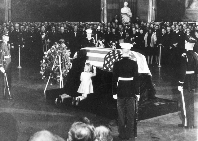Jackie Kennedy kisses the casket of her late husband, President John F. Kennedy while her daughter Caroline touches it in rotunda of U.S. Capitol, on November 24, 1963. (Photo by AP Photo)