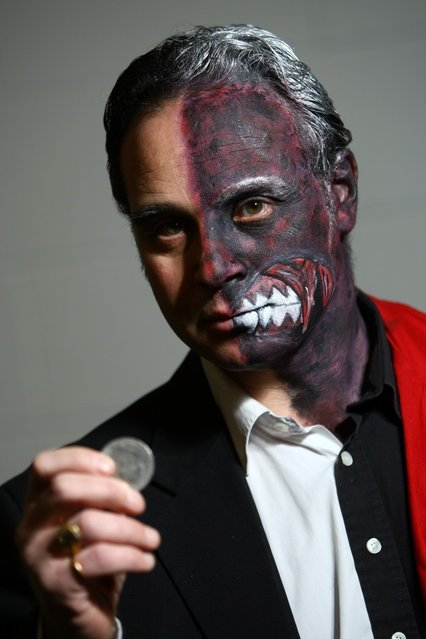 An actor dressed as Two-Face from the film Batman poses for a photo at the London Super Comic Convention at the ExCeL Centre on February 23, 2013 in London, England. Enthusiasts at the Comic Convention are encouraged to wear a costume of their favourite comic character and flock to the ExCeL to gather all the latest news in the world of comics, manga, anime, film, cosplay, games and cult fiction. (Photo by Jordan Mansfield)