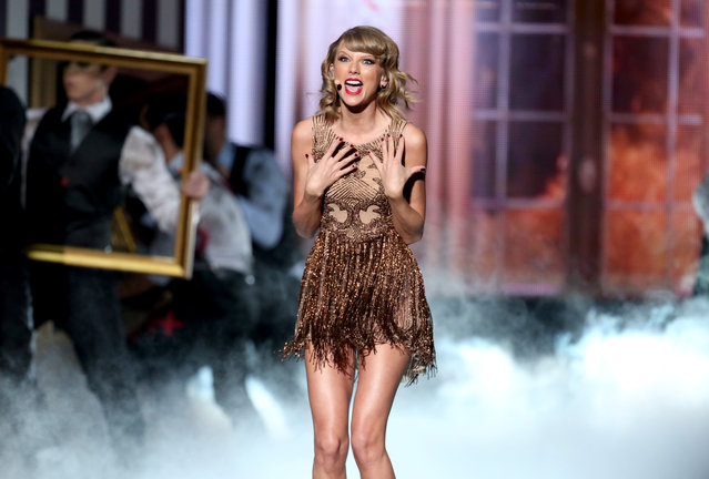 Taylor Swift performs on stage at the 42nd annual American Music Awards at Nokia Theatre L.A. Live on Sunday, November 23, 2014, in Los Angeles. (Photo by Matt Sayles/Invision/AP Photo)
