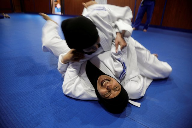 Amal Khalifa, a female Palestinian colonel, practices martial art in Ramallah in the Israeli-occupied West Bank on August 18, 2020. (Photo by Raneen Sawafta/Reuters)