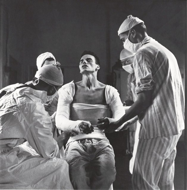 Army medic George Lott, wounded in both arms in November, 1944, grimaces as doctors mold a cast to his body. When Lott embarked on a 4,500-mile, seven-hospital journey of recovery, photographer Ralph Morse – astonished by the high level of medical care wounded troops received both at the front and behind the lines – traveled with him, and chronicled Lott's odyssey in a revelatory cover story for LIFE. (Photo by Ralph Morse/Time & Life Pictures)