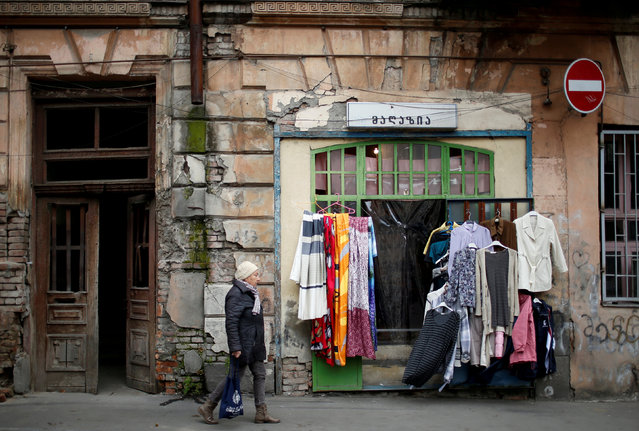 A woman passes by a second hand shop in Tbilisi, Georgia, February 16, 2018. (Photo by David Mdzinarishvili/Reuters)