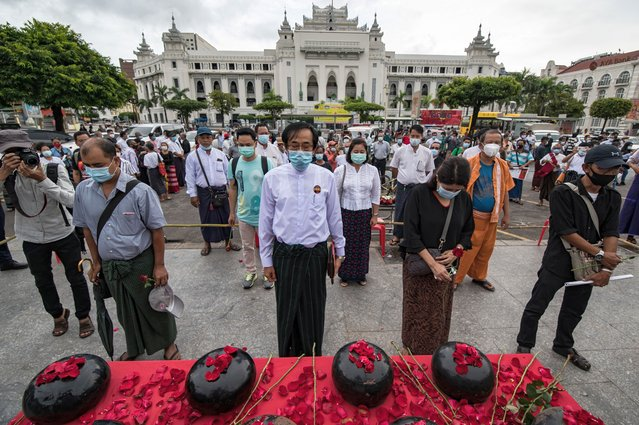 People standing in silent during a ceremony to mark the 32nd anniversary of the 8888 uprising in front of city hall in Yangon, Myanmar on August 8, 2020. This year marks the 32nd anniversary of the democratic uprising against the military junta that ended in a bloody crackdown in 1988. (Photo by Shwe Paw Mya Tin/NurPhoto via Getty Images)