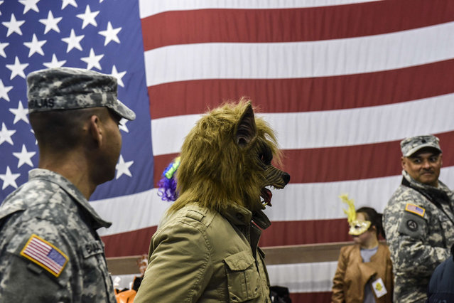A U.S soldier wearing a werewolf mask takes part in a Halloween party at the US military camp Bondsteel near the town of Ferizaj on October 30, 2015. (Photo by Armend Nimani/AFP Photo)