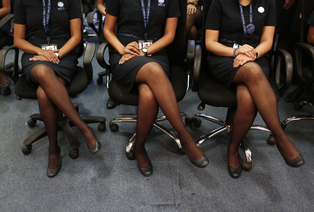 Prospective flight attendants listen to their instructor during an etiquette training course at Indigo Airlines' Ifly training centre in Gurgaon on the outskirts of New Delhi November 18, 2014. (Photo by Adnan Abidi/Reuters)