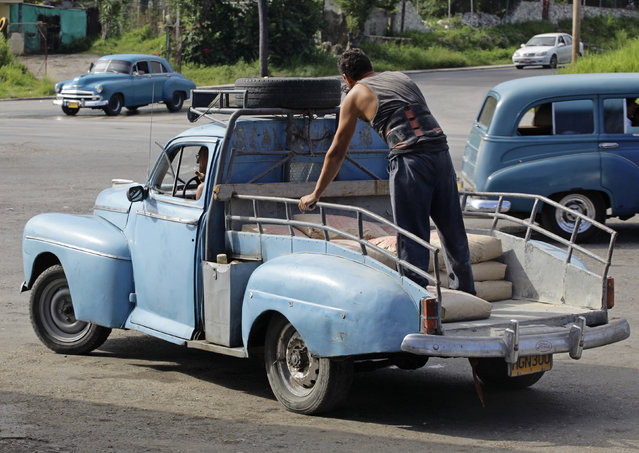 A modified 1948 Ford Deluxe sedan with a load of cement sacks in Havana, July 12, 2012. (Photo by Desmond Boylan/Reuters)
